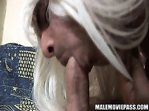 Crossdressing amateur hunk sucking on a hard cock