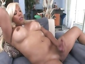 Blonde pornstar with huge boobs riding