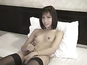 Small tits tgirl enjoys dick stroking
